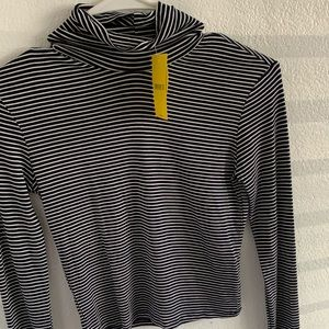 Long sleeve black and white striped turtle neck